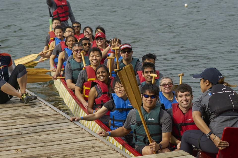 Employees participating in Dragonboat!