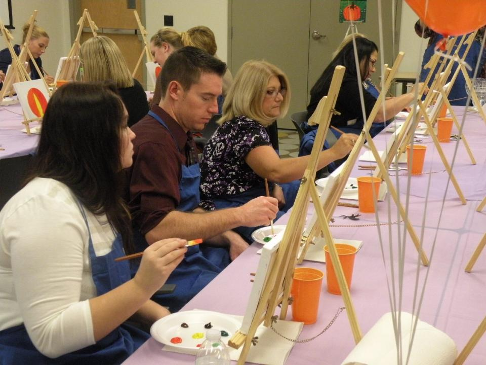 Don't be stressed! As part of our award-winning wellness program, employees take part in a fun painting class as part of a recent stress management campaign.