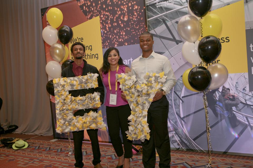 Young staffers celebrate their EY spirit at an EY event.