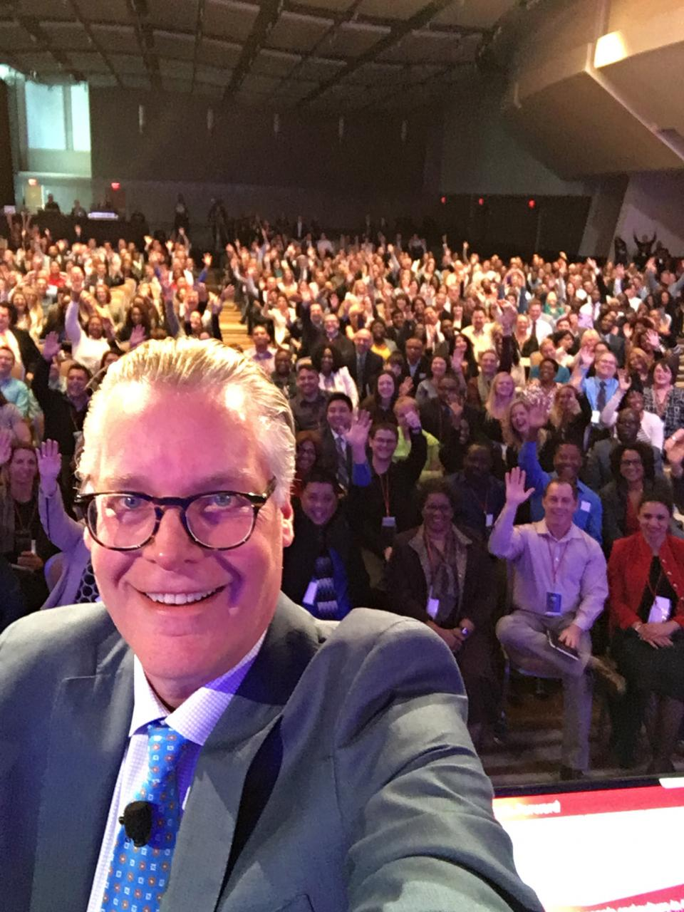Delta CEO Ed Bastian takes a moment for a selfie with employees