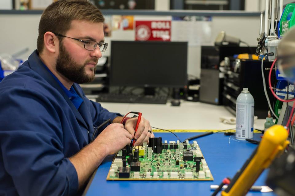 Electronic Repair Technician repairs Printed Circuit Board