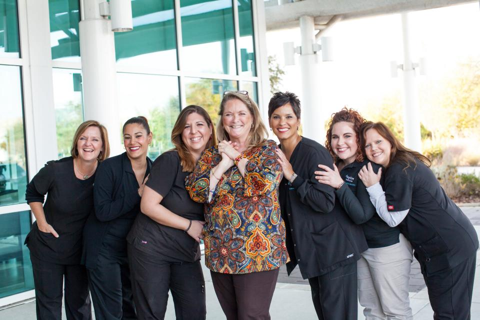 Smiling team members at a BayCare Outpatient Imaging center in Lutz, FL. BayCare offers imaging services such as CT, interventional radiology, MRI, mammography and women's imaging, nuclear medicine imaging, pediatric imaging, ultrasound, and x-ray.