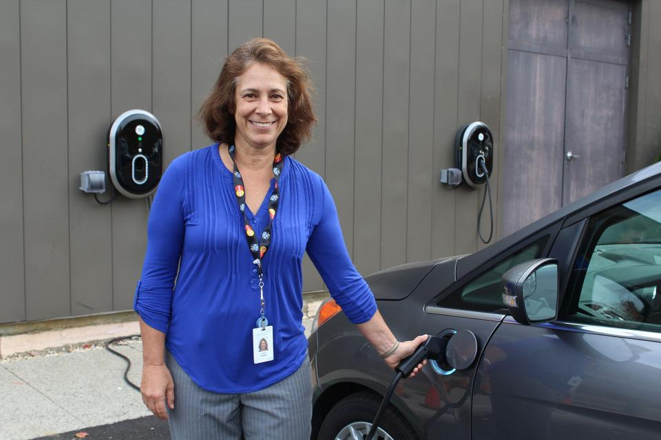 Recharging your car … – Free charging stations for electric vehicles provide an added incentive for employees to abandon their gas-guzzling ways. Laura Heinlein gets her battery topped off at Realogy's Danbury, Connecticut site.