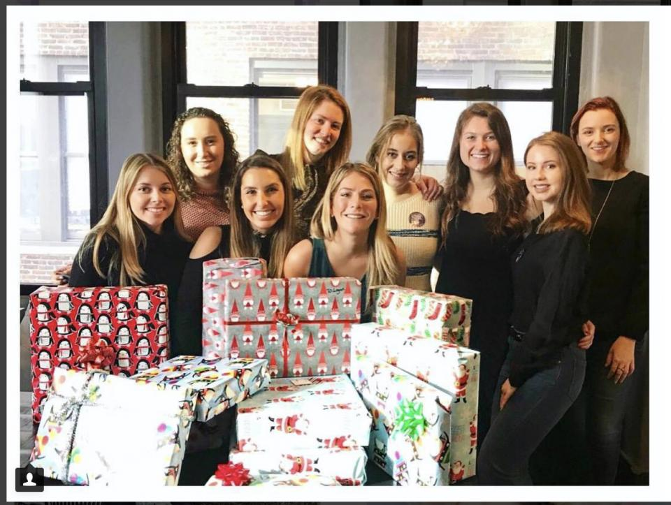 EvolveMKD Volunteer Day Wrapping Holiday Gifts for Charity