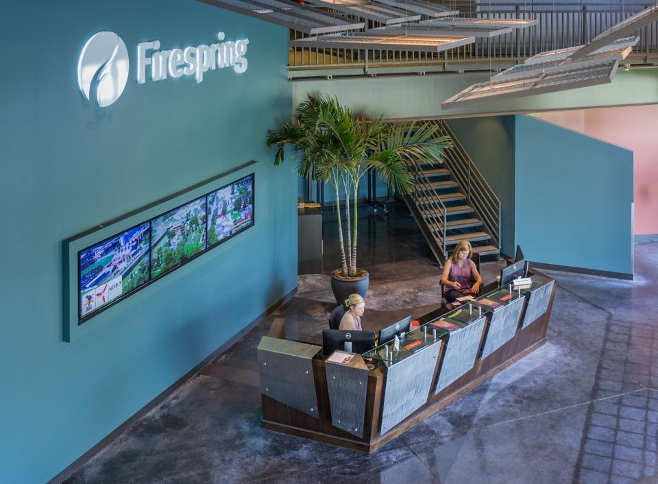 Visitors are greeted with a friendly smile and a glimpse of Firespring's video and interative portfolio.