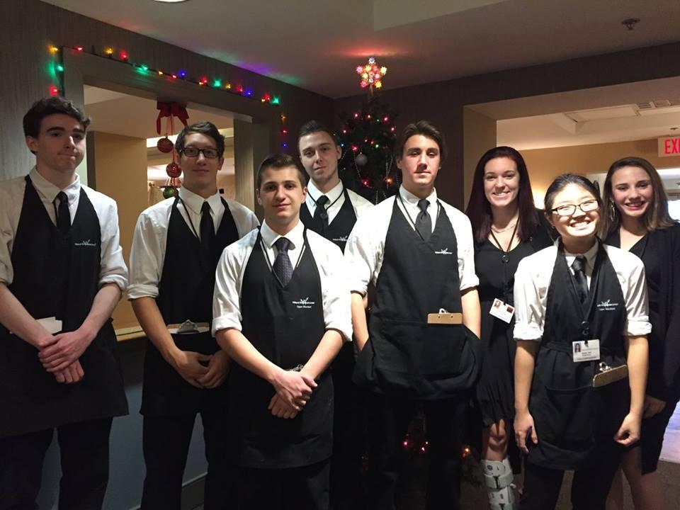 Dining Servers getting ready for the holiday party