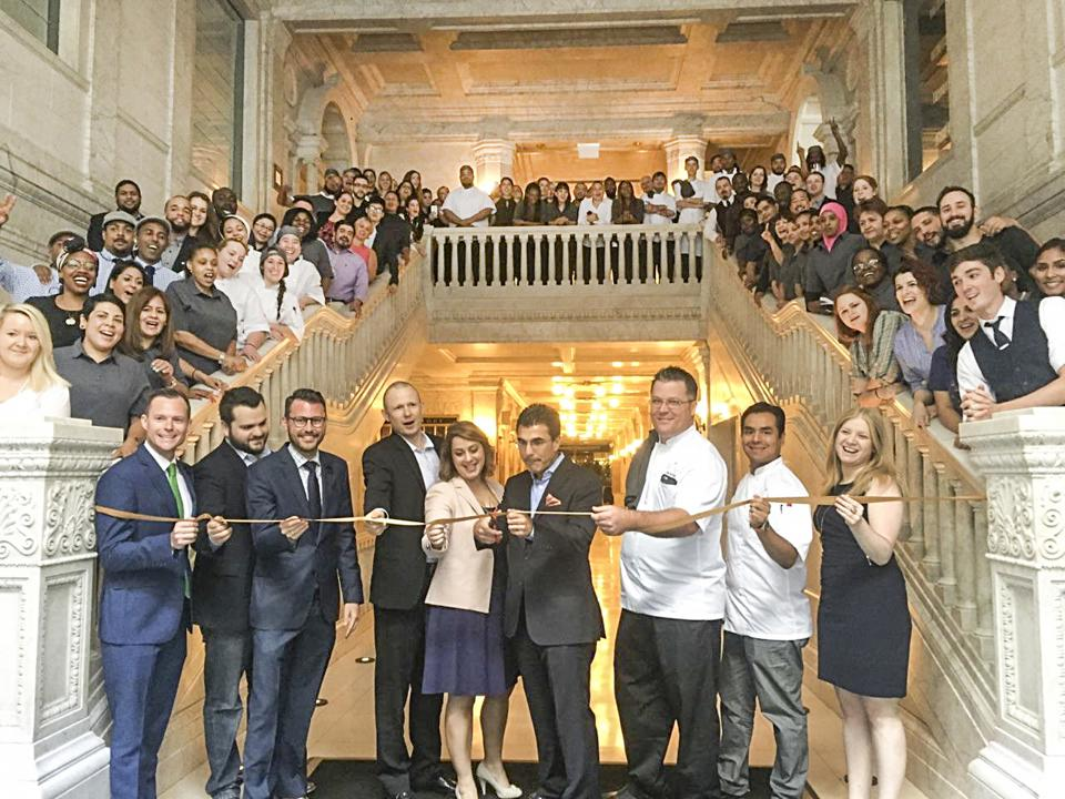 Employee Ribbon cutting Gray Hotel Chicago