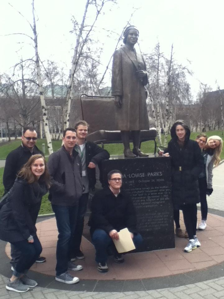 Plante Moran's spring interns pose alongside a statue of Rosa Parks as part of a scavenger hunt in Grand Rapids, Michigan.