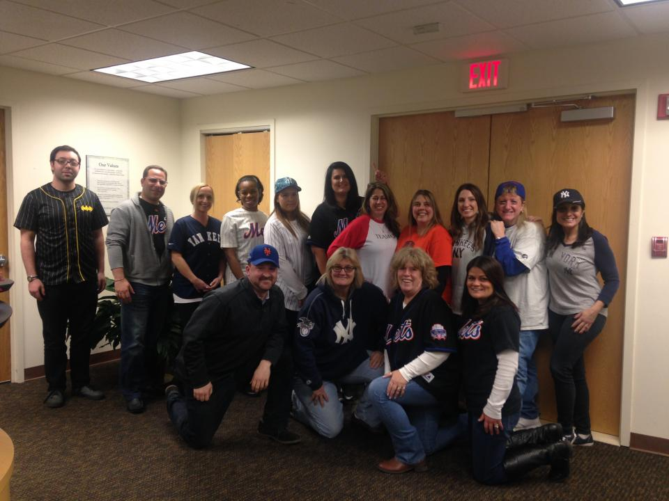 Here are members of our Garden City office celebrating MLB Opening Day!