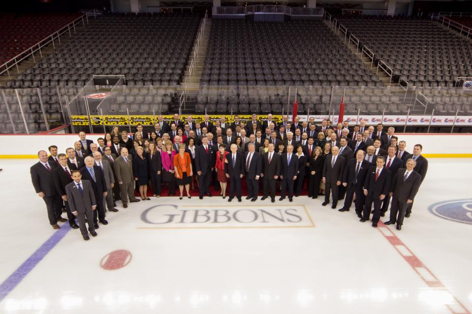 Gibbons takes center ice! Employees of the firm gather at the Prudential Center to celebrate the Gibbons logo prominently displayed on the ice.