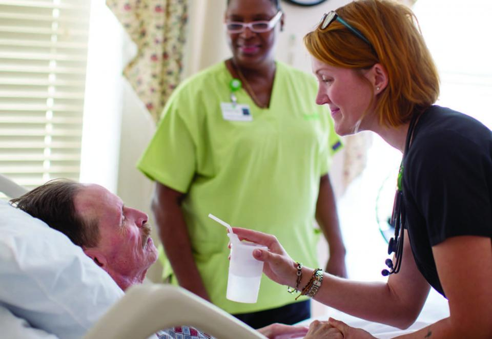 Gilchrist hospice aide and nurse caring for patient