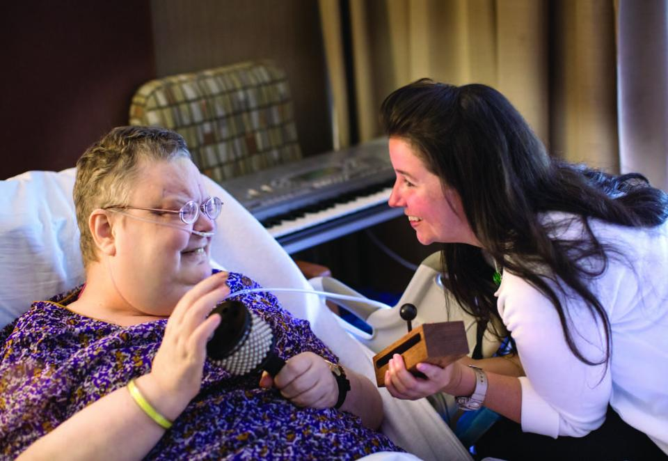 Gilchrist music therapist with patient