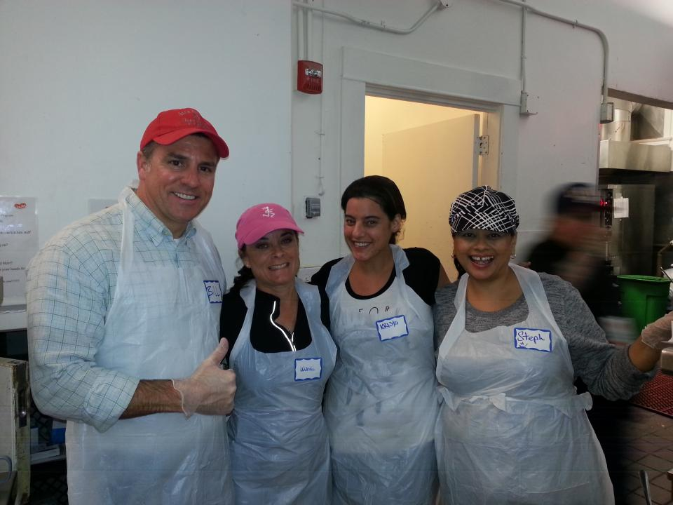 National MI employees serving food at Glide Memorial Church in San Francisco