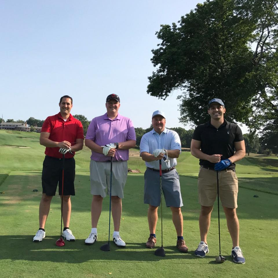 Members of the team golfing