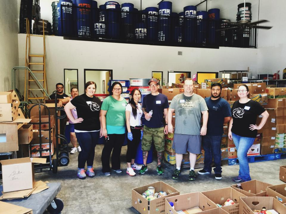 Employees volunteering at a food pantry in Southern California