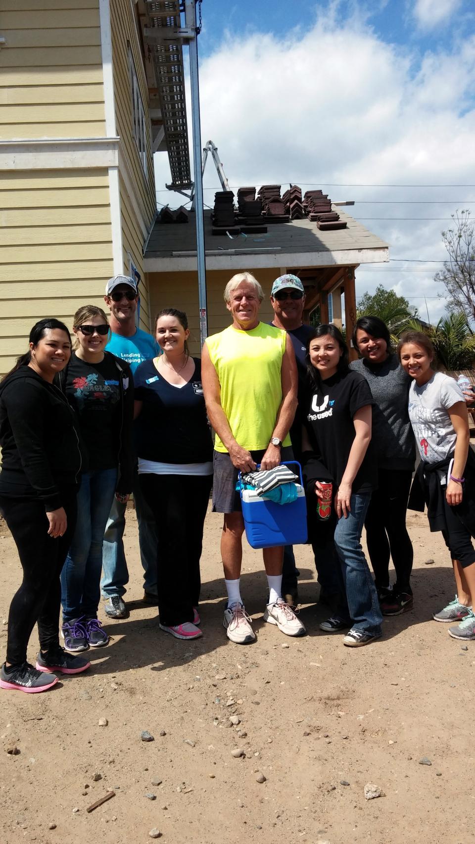 Employees volunteering with Habitat For Humanity Orange County.