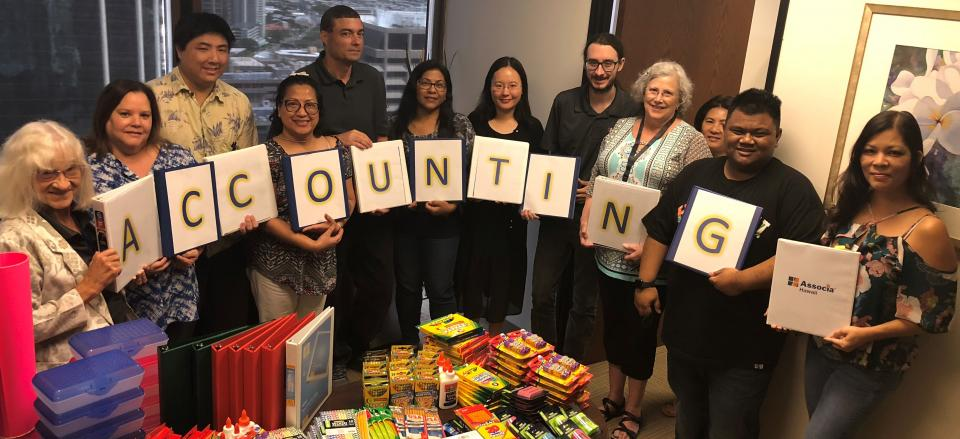 The Associa Hawaii accounting team collected the most school supplies for needy children in their community!