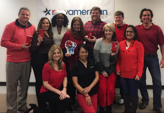 Employees from New American Funding – Atlanta wear red to support heart health.