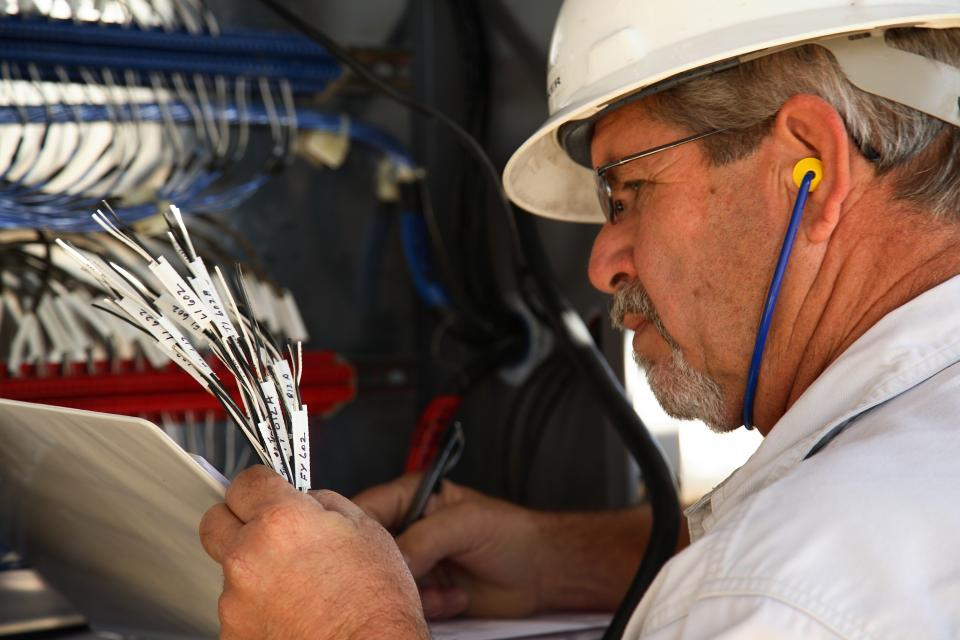 Hilcorp Electrician Working in the Field