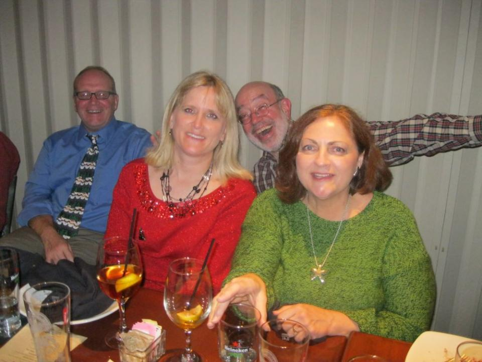 Charlotte office employees enjoy an evening of great food and company.