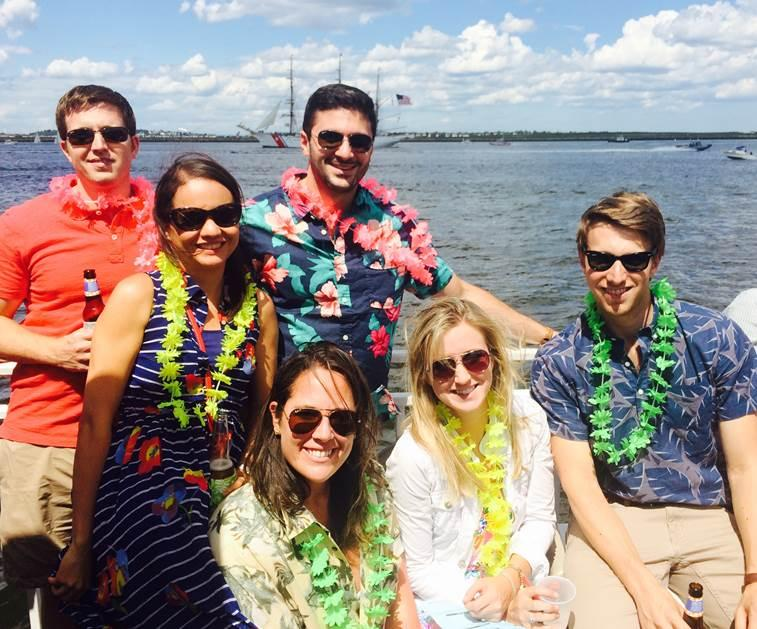 Shawmut employees enjoying a boat cruise around Boston Harbor as a part of their summer outing.