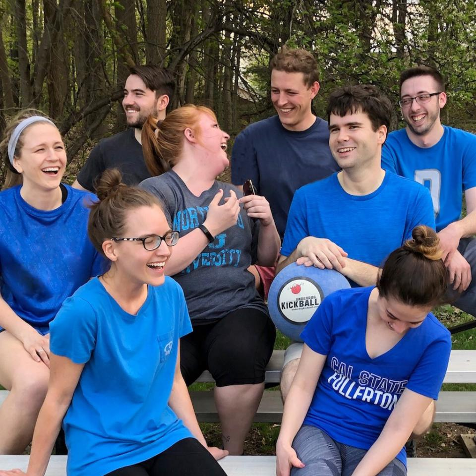 Associates enjoy playing in their after-work kickball league.