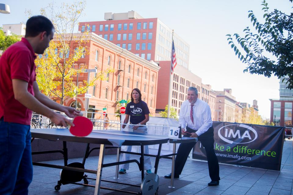To support the IMA Foundation, IMA annually hosts an outdoor ping pong tournament with nearly 400 participants as a fundraiser for area nonprofits.