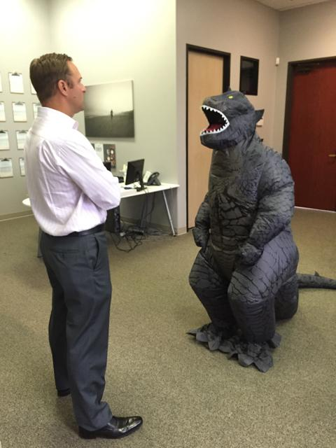 Team member speaking to the CEO on Halloween