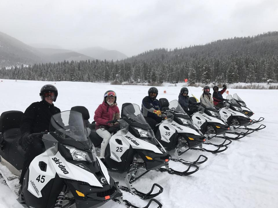 Who doesn't love snowmobiling with your coworkers?!