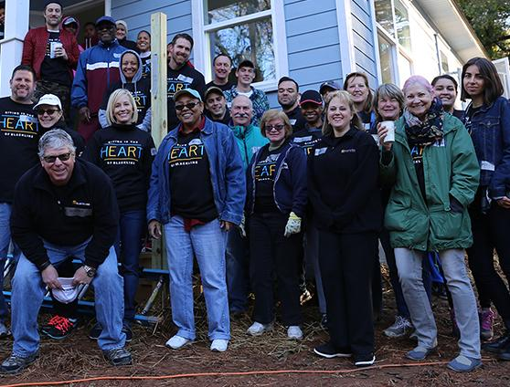 Employees working with Habitat for Humanity