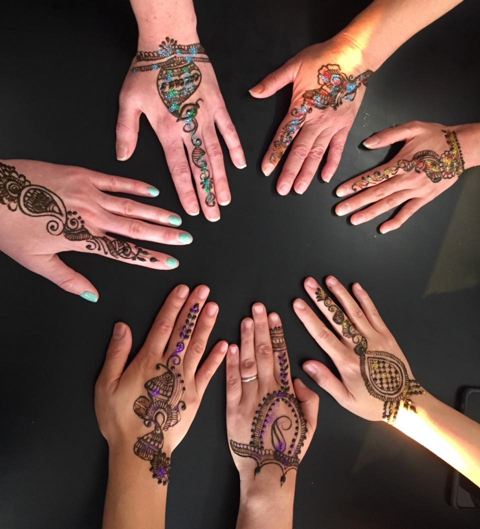 A Diwali celebration organized by employees who wanted to share their cultural traditions included henna painting, games, and lots of food.