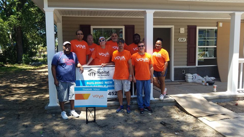 Voya employees in Jacksonville, Florida, assist Habitat for Humanity as part of the company's National Day of Service.