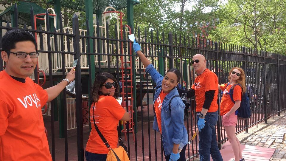 Voya employees in New York City fix up a playground as part of the company's National Day of Service.