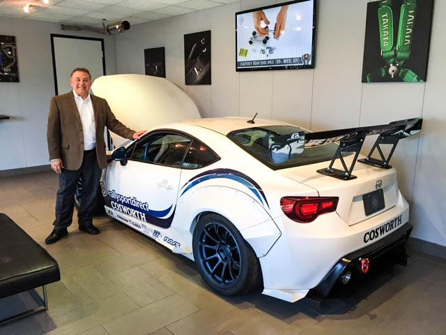 Senior Consultant, Joe Velez in the lobby at an automotive client.