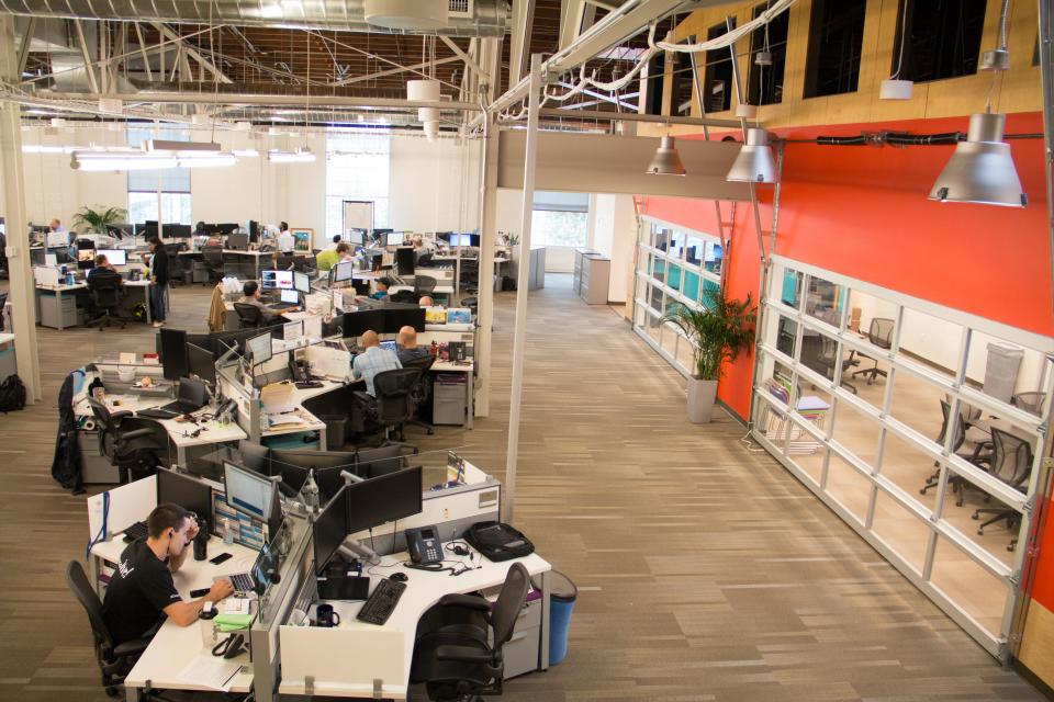 """Our downtown Nashville office was designed to encourage collaboration. Leaders here have an """"open door"""" policy, meaning they don't sit in offices, but sit in open space cubes, just like all employees."""