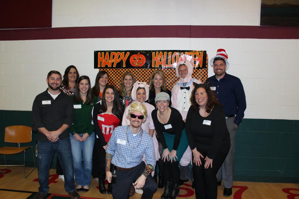 Employees volunteering at the United Way Halloween Dance