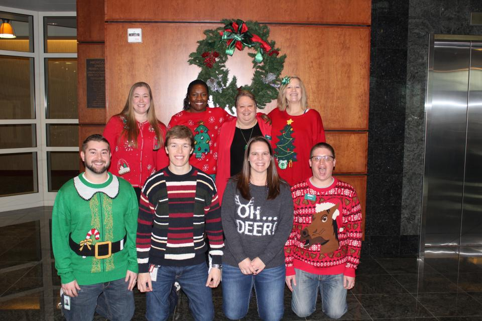 Employees participating in Festive Sweater Day