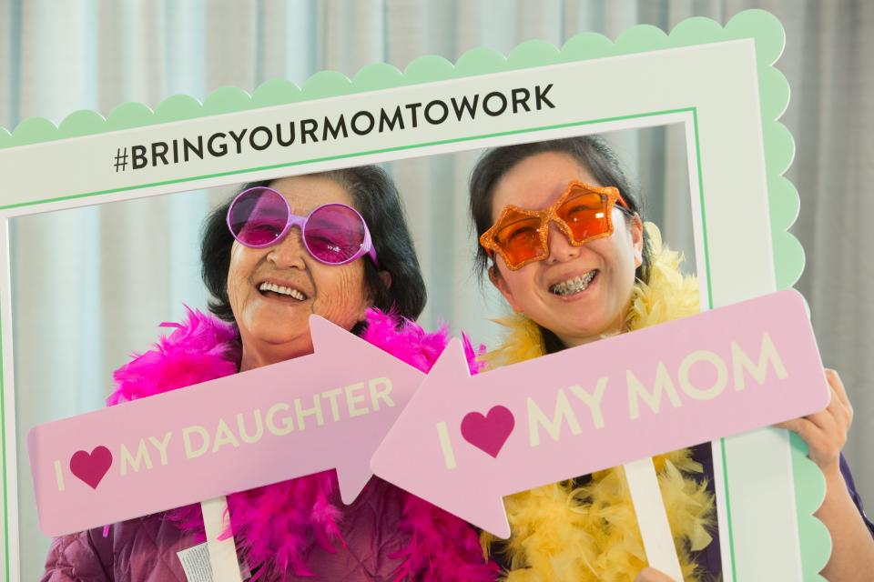 An employee celebrates with her mom at Abbott's Bring Your Mom to Work event to celebrate Mother's Day 2017.