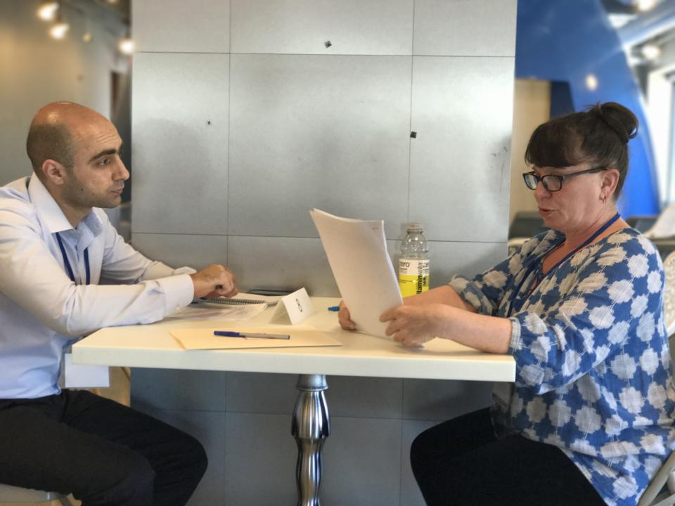 Amber didn't miss the opportunity to volunteer for resume reviewing and interview guidance when Upwardly Global brought a group of Syrian refugees to our HQ.