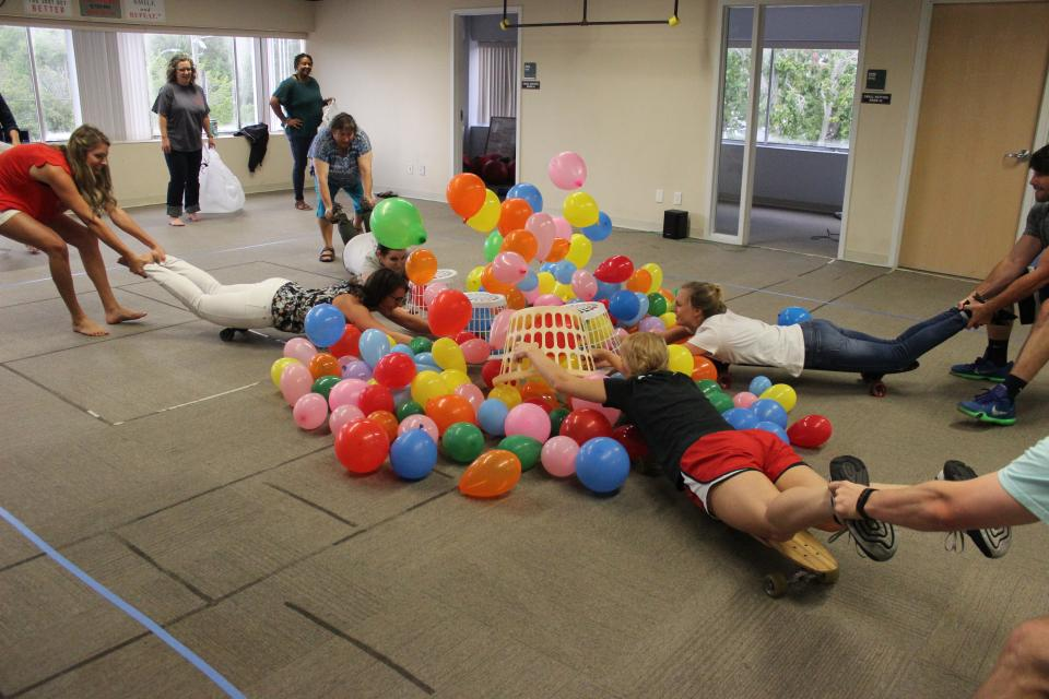 In this year's office olympics, one of the games was hungry hungry hippo, where we had to trap as many balloons as possible in a laundry basket while your partner maneuvers you around on a skateboard.