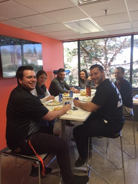 BCT team members chowing down on some ballpark fare to celebrate Detroit Tigers opening day 2017
