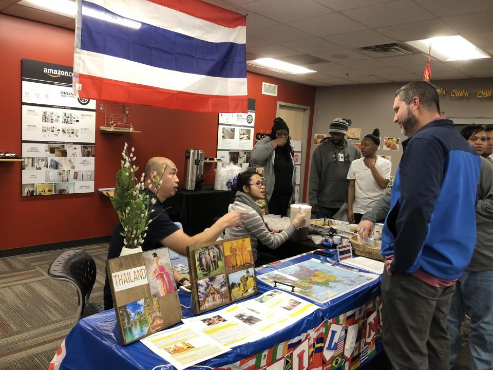 Employees learning about cultures around the world at the Cultural Fair