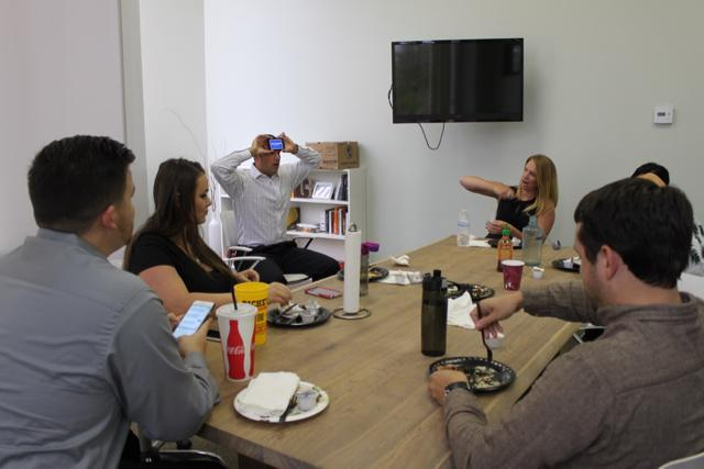 Jonathan Gallagher, CEO, playing Heads Up with the team during a Friday catered lunch