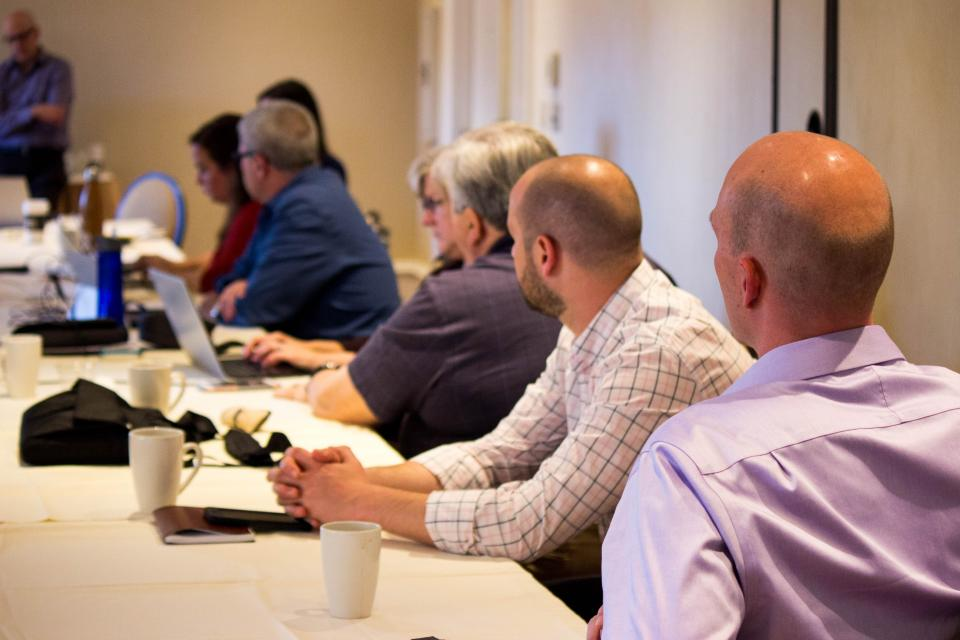 The Ultra team listening as Managing Parter, Jeff Carr speaks at a recent in-person meeting