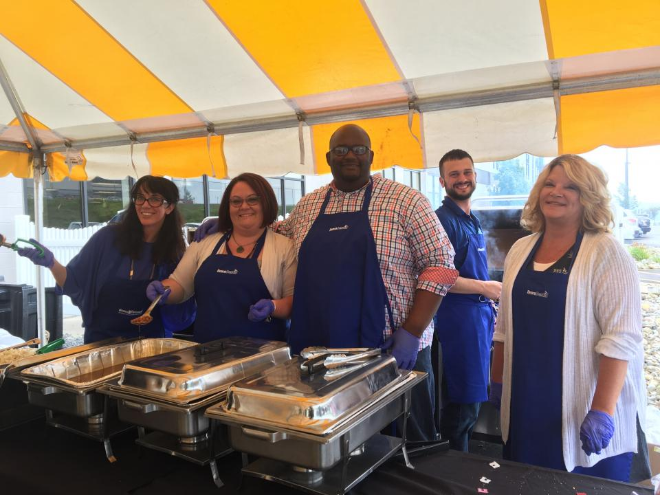 Annual BBQ Summer 2018-Managers Serving Lunch