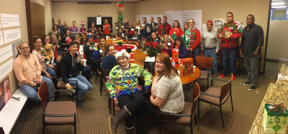 Our corporate office celebrating at the 2016 holiday party.