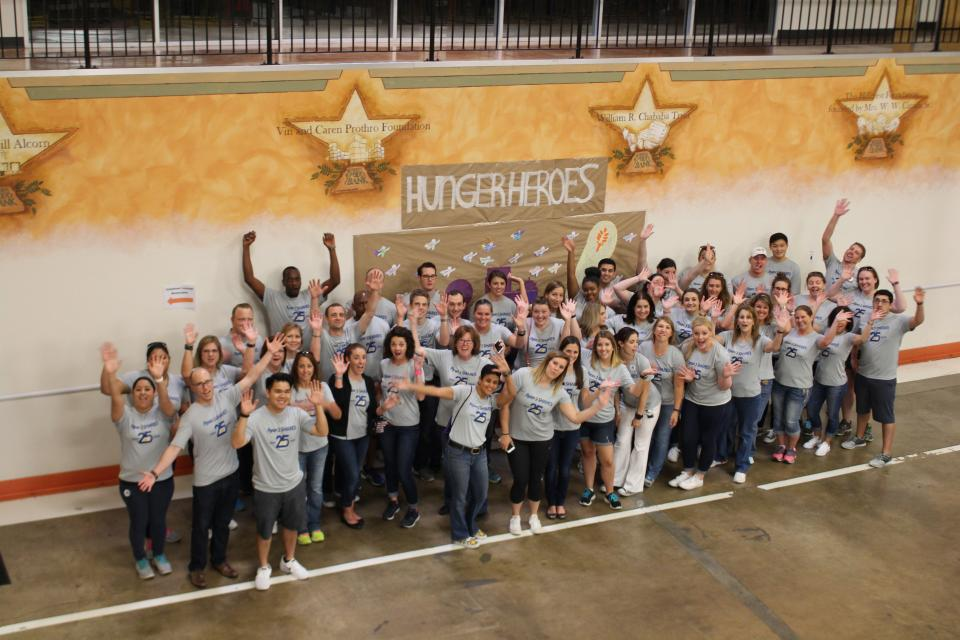 Ryan employees celebrate Ryan's 25th anniversary by volunteering at the North Texas Food Bank during Ryan's Global Outreach Day -RyanSHARES Day.