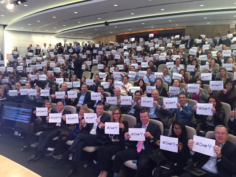 SAP colleagues in Newtown Square show their support for the #One4 project