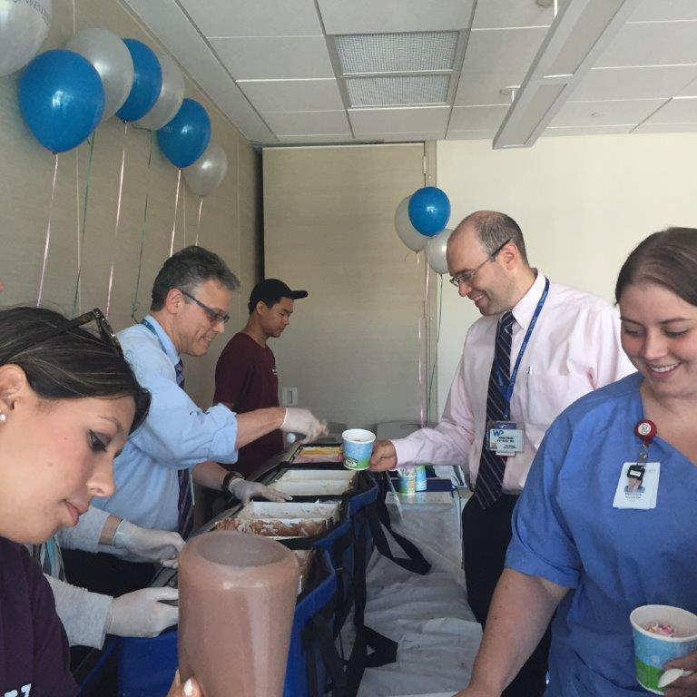 Dr Meixler Serving Employees at Ice Cream Day