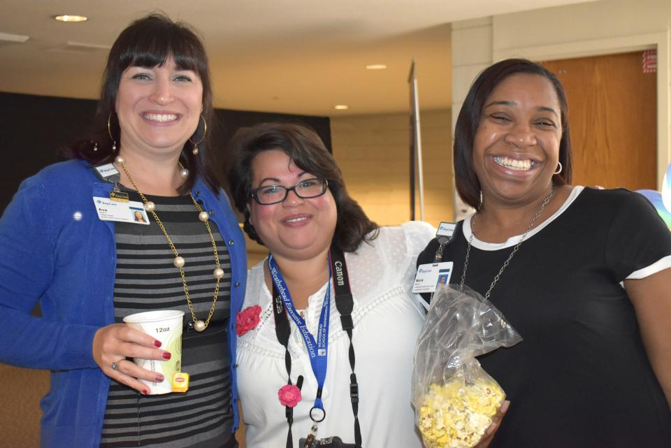 Team members enjoy a popcorn break at BayCare's team member engagement forum.